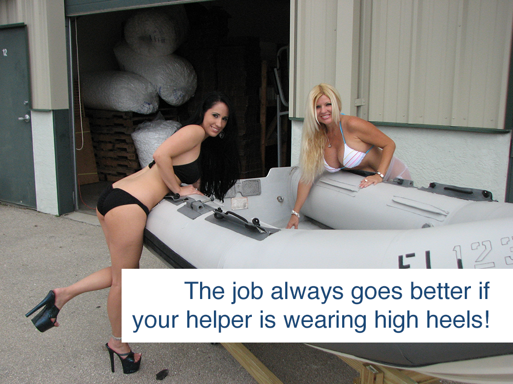 women posing with inflatable boat restored to like-new condition using inland marine inflatable boat repair products